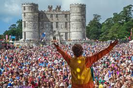 Bestival Lulworth castle minibus hire